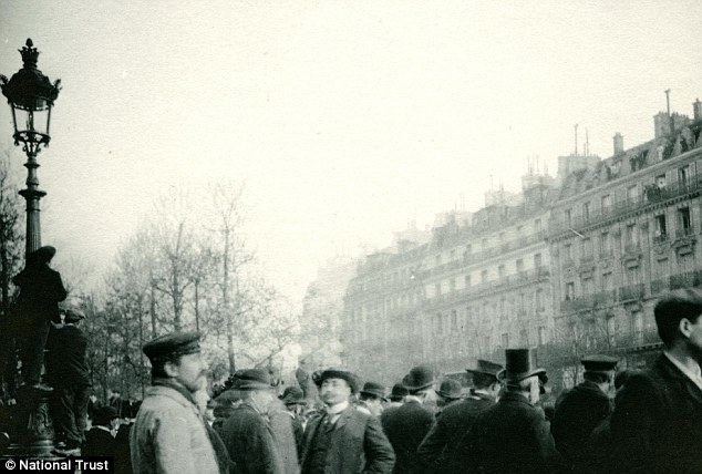 Crowds queue in Paris to see Rodin's sculpture The Thinker in 1904 in another snap from Shaw's private photo collection